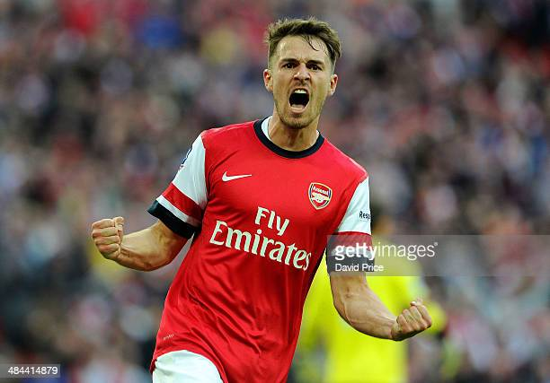 Aaron Ramsey celebrates Arsenal's 1st goal during the match between Arsenal and Wigan Athletic in the FA Cup Semi Final at Wembley Stadium on April...
