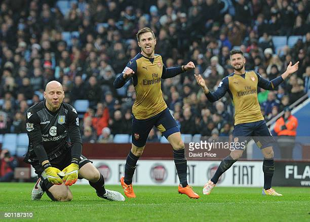 Aaron Ramsey celebrates scoring Arsenal's 2nd goal as Brad Guzan of Villa looks on during the Barclays Premier League match between Aston Villa and...