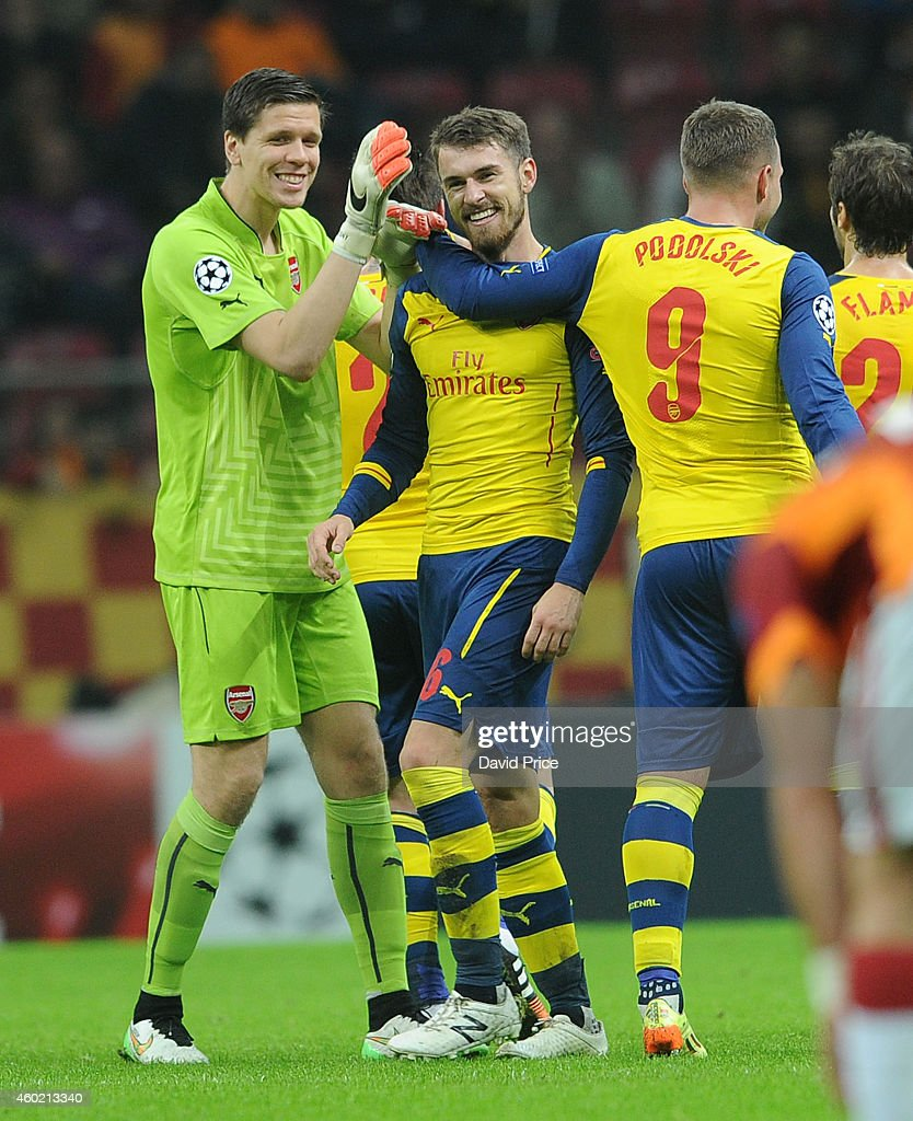 Aaron Ramsey celebrates scoring his 2nd goal, Arsenal's 3rd, with Wojciech Szczesny and Lukas Podolski during the match between Galatasaray and Arsenal in the UEFA Champions League on December 9, 2014 in Istanbul, Turkey.