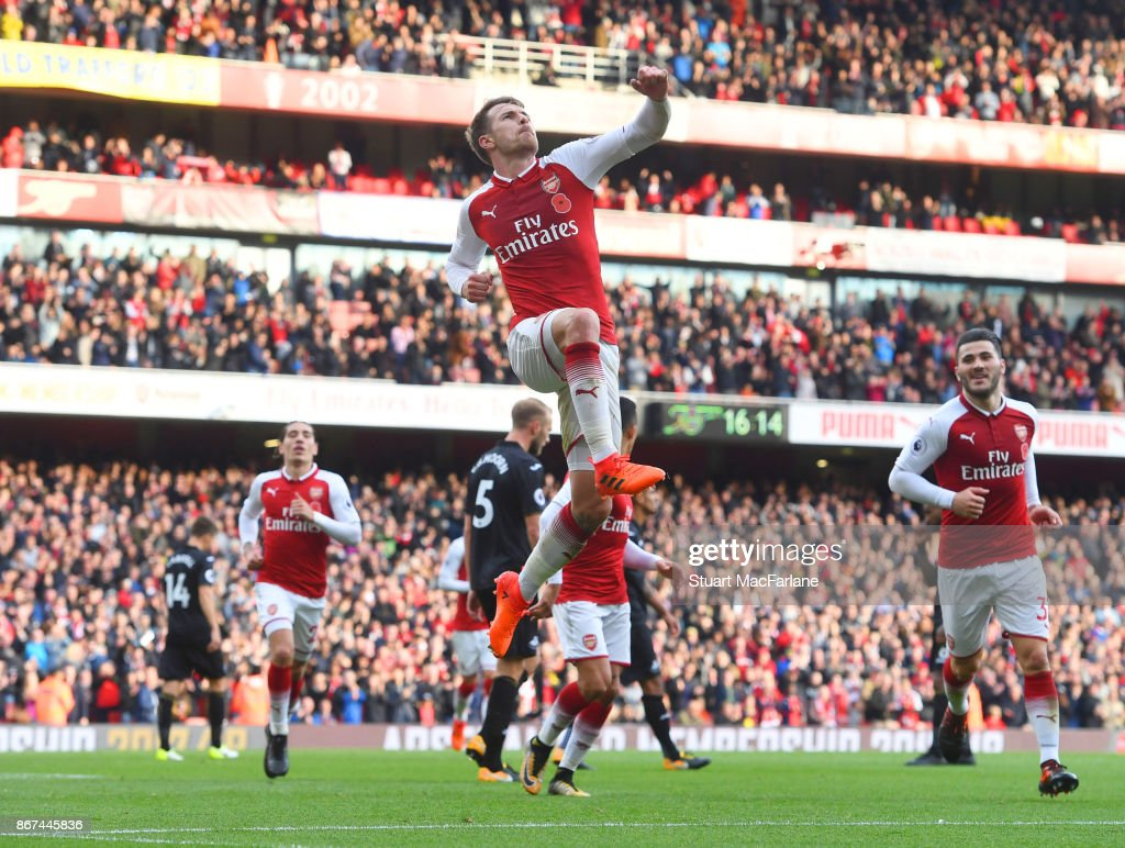 Aaron Ramsey celebrates scoring the 2nd Arsenal goal during the Premier League match between Arsenal and Swansea City at Emirates Stadium on October 28, 2017 in London, England.