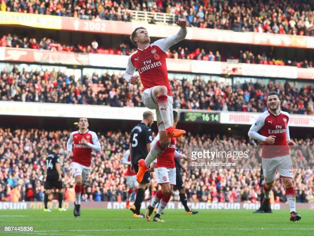 Aaron Ramsey celebrates scoring the 2nd Arsenal goal during the Premier League match between Arsenal and Swansea City at Emirates Stadium on October...