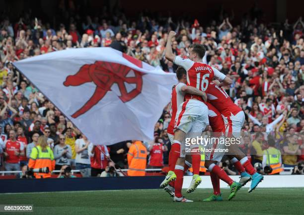 Aaron Ramsey celebrates scoring the 3rd Arsenal goal eith Rob Holding the Premier League match between Arsenal and Everton at Emirates Stadium on May...
