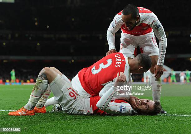 Aaron Ramsey celebrates scoring the 3rd Arsenal goal with Kieran Gibbs and Theo Walcott during the Barclays Premier League match between Arsenal and...