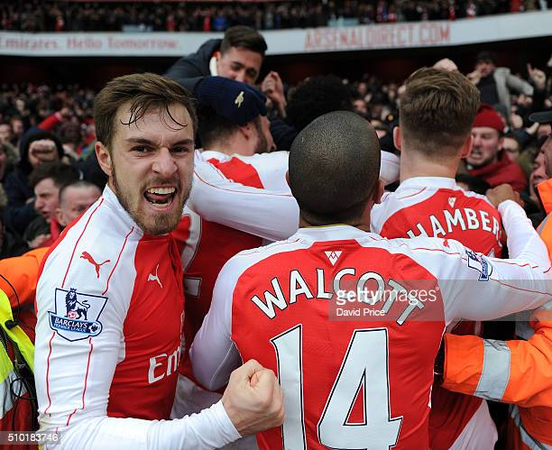 Aaron Ramsey celebrates the second Arsenal goal with fans during the Barclays Premier League match between Arsenal and Leicester City at Emirates...