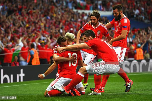 Aaron Ramsey f Wales celebrates scoring his team's first goal with his team mates during the UEFA EURO 2016 Group B match between Russia and Wales at...