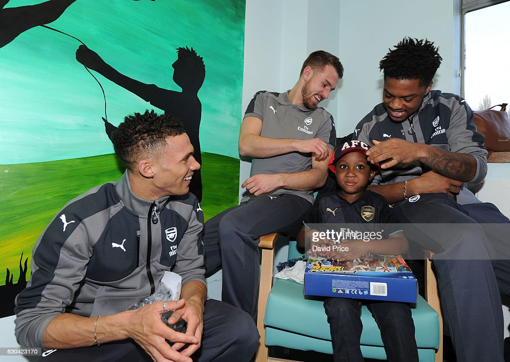 Aaron Ramsey, Kieran Gibbs and Chuba Akpom of Arsenal visit the patients on the childrens ward at Whittington Hospital on December 22, 2016 in London, England.
