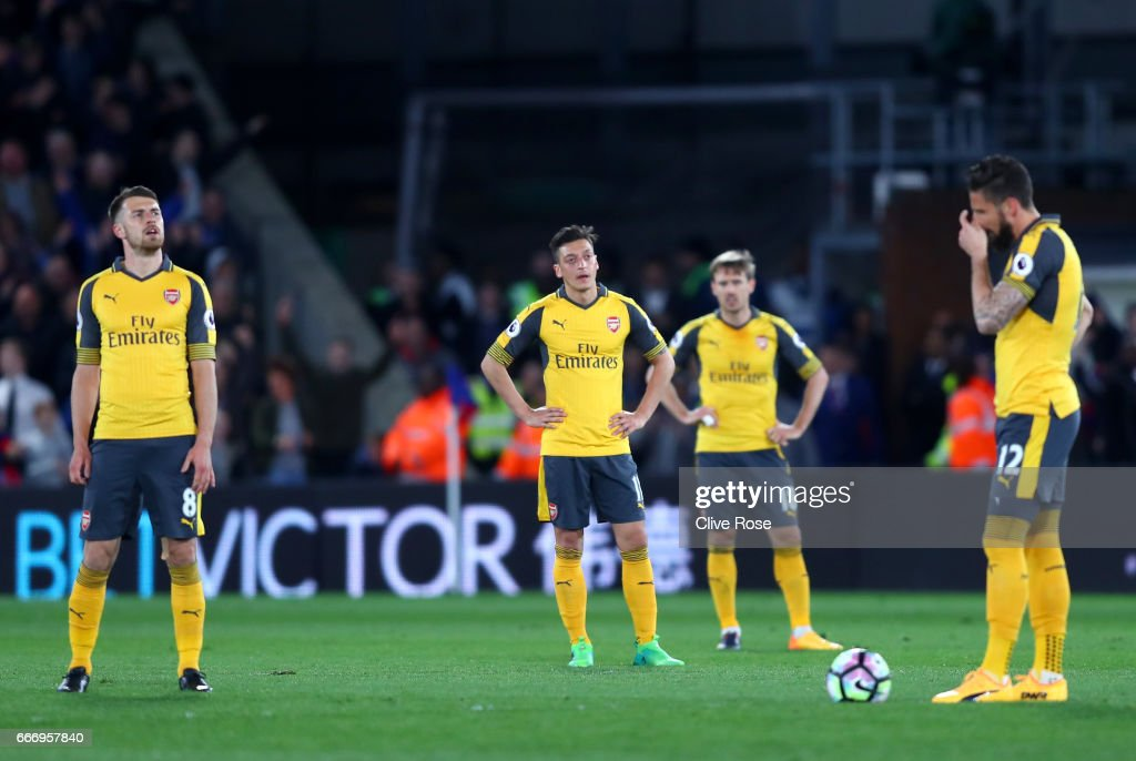 Aaron Ramsey, Mesut Ozil, Nacho Monreal and Olivier Giroud of Arsenal look dejected during the Premier League match between Crystal Palace and Arsenal at Selhurst Park on April 10, 2017 in London, England.