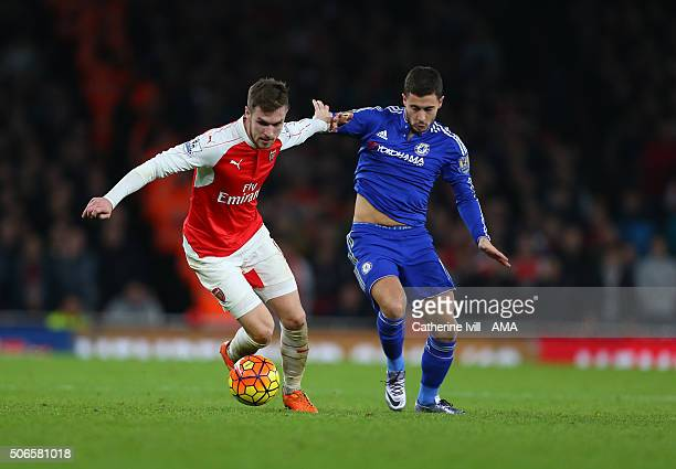 Aaron Ramsey of Arsenal and Eden Hazard of Chelsea during the Barclays Premier League match between Arsenal and Chelsea at the Emirates Stadium on...