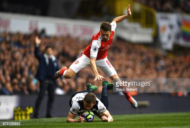 Aaron Ramsey of Arsenal and Jan Vertonghen of Tottenham Hotspur battle for possession during the Premier League match between Tottenham Hotspur and...