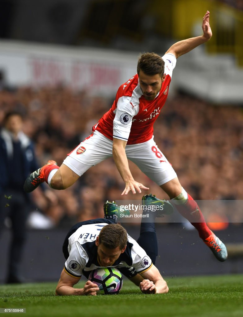Aaron Ramsey of Arsenal and Jan Vertonghen of Tottenham Hotspur battle for possession during the Premier League match between Tottenham Hotspur and Arsenal at White Hart Lane on April 30, 2017 in London, England.