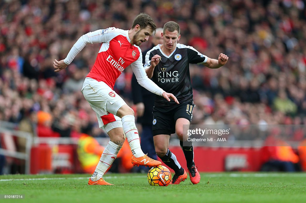 Aaron Ramsey of Arsenal and Marc Albrighton of Leicester City during the Barclays Premier League match between Arsenal and Leicester City at the Emirates Stadium on February 14, 2016 in London, England.