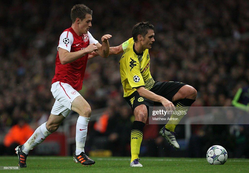 Aaron Ramsey of Arsenal and Sebastian Kehl of Borussia Dortmund