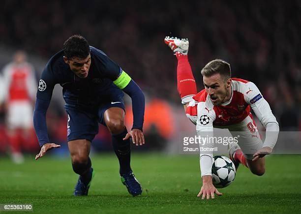 Aaron Ramsey of Arsenal and Thiago Silva of PSG battle for possession during the UEFA Champions League match between Arsenal FC and Paris...