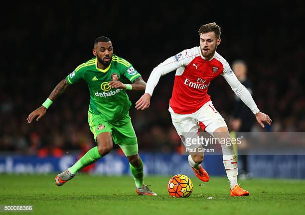 Aaron Ramsey of Arsenal and Yann M'Vila of Sunderland compete for the ball during the Barclays Premier League match between Arsenal and Sunderland at...