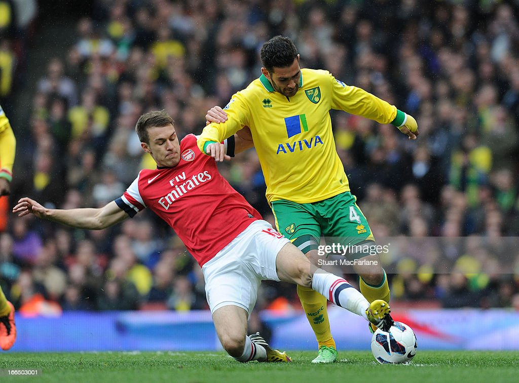 <a gi-track='captionPersonalityLinkClicked' href=/galleries/search?phrase=Aaron+Ramsey&family=editorial&specificpeople=4784114 ng-click='$event.stopPropagation()'>Aaron Ramsey</a> of Arsenal battles with Bradley Johnson of Norwich during the Barclays Premier League match between Arsenal and Norwich City at Emirates Stadium on April 13, 2013 in London, England.
