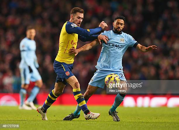 Aaron Ramsey of Arsenal battles with Gael Clichy of Manchester City during the Barclays Premier League match between Manchester City and Arsenal at...