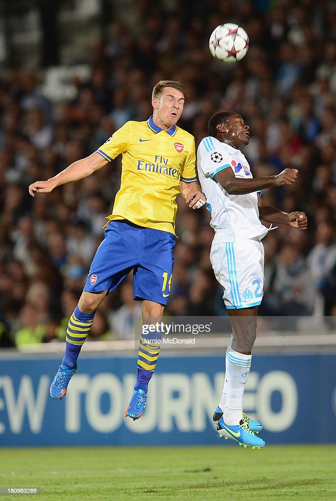 Aaron Ramsey of Arsenal battles with Rod Fanni of Olympique de Marseilleduring the UEFA Champions League group F match between Olympique de Marseille...