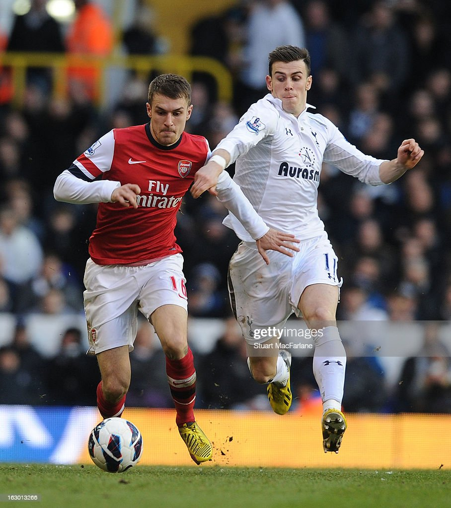 Aaron Ramsey of Arsenal breaks past Gareth Bale of Tottenham during the Barclays Premier League match between Tottenham Hotspur and Arsenal at White Hart Lane on March 3, 2013 in London, England.
