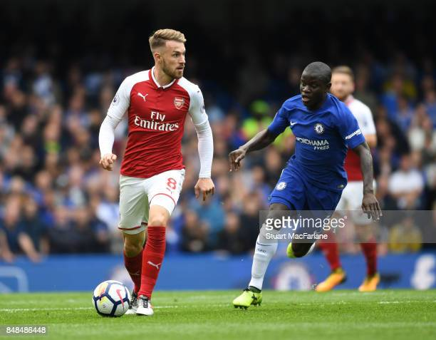 Aaron Ramsey of Arsenal breaks past N'Golo Kante of Chelsea during the Premier League match between Chelsea and Arsenal at Stamford Bridge on...