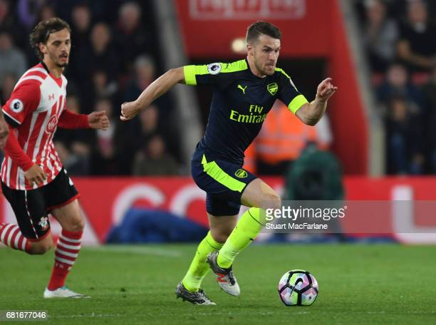Aaron Ramsey of Arsenal brraks past Manolo Gabbiadini of Southampton during the Premier League match between Southampton and Arsenal at St Mary's...