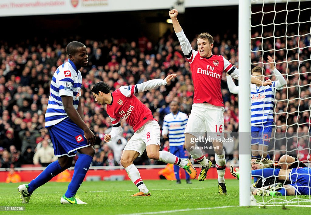 Aaron Ramsey #16 of Arsenal celebrates after teammate Mikel Arteta #8 scores the opening goal during the Barclays Premier League match between Arsenal and QPR at The Emirates Stadium on October 27, 2012 in London, England.