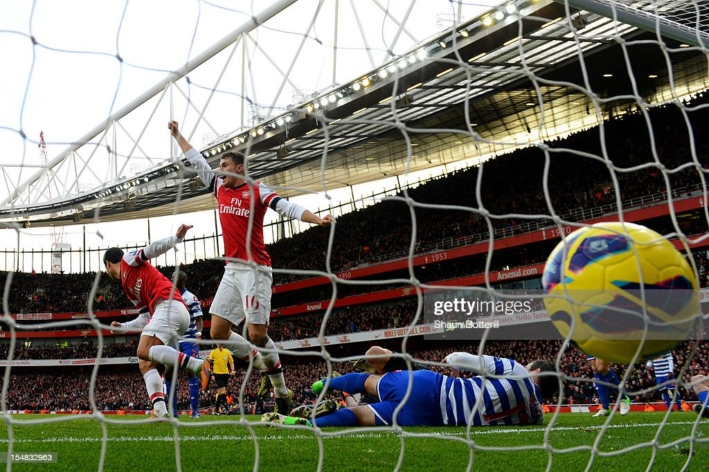 <a gi-track='captionPersonalityLinkClicked' href=/galleries/search?phrase=Aaron+Ramsey&family=editorial&specificpeople=4784114 ng-click='$event.stopPropagation()'>Aaron Ramsey</a> #16 of Arsenal celebrates after teammate <a gi-track='captionPersonalityLinkClicked' href=/galleries/search?phrase=Mikel+Arteta&family=editorial&specificpeople=235322 ng-click='$event.stopPropagation()'>Mikel Arteta</a> #8 scores the opening goal during the Barclays Premier League match between Arsenal and QPR at The Emirates Stadium on October 27, 2012 in London, England.