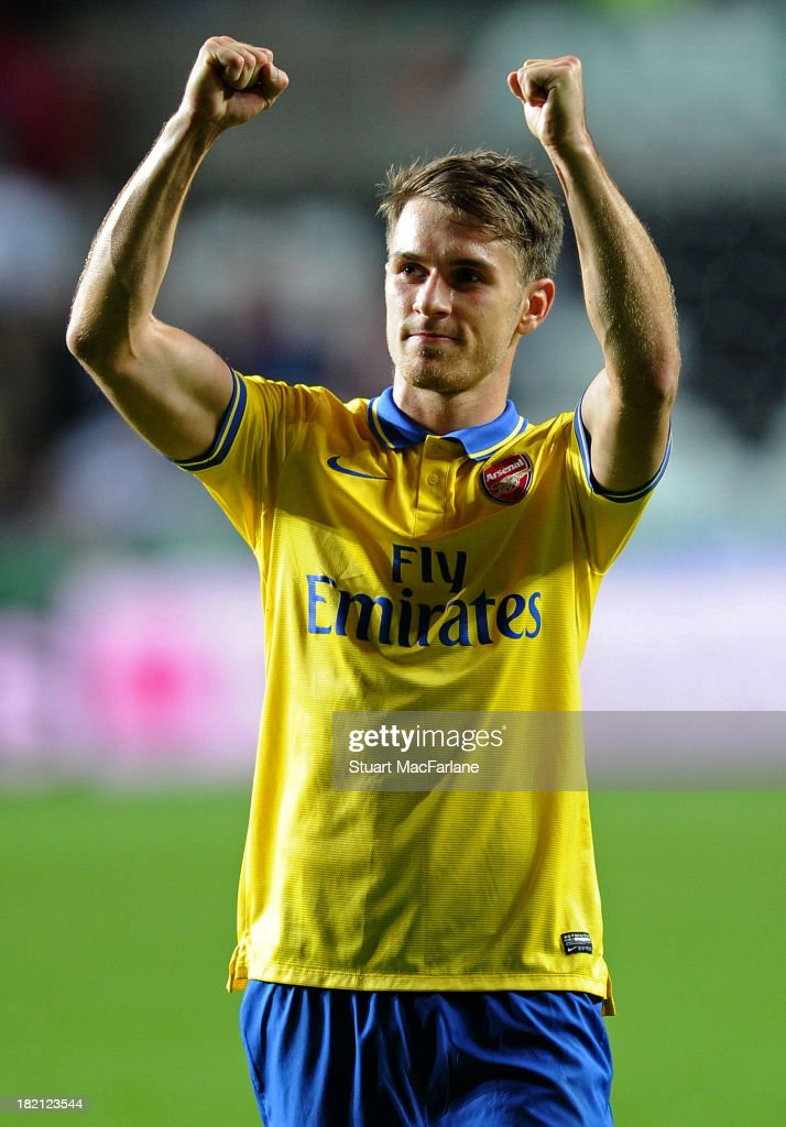 <a gi-track='captionPersonalityLinkClicked' href=/galleries/search?phrase=Aaron+Ramsey&family=editorial&specificpeople=4784114 ng-click='$event.stopPropagation()'>Aaron Ramsey</a> of Arsenal celebrates after the Barclays Premier League match between Swansea and Arsenal at Liberty Stadium on September 28, 2013 in Swansea, Wales.