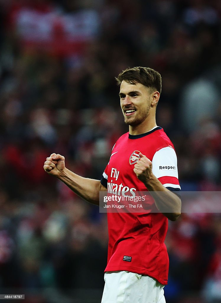 Aaron Ramsey of Arsenal celebrates after winning the penalty shoot-out to claim victory in the FA Cup Semi-Final match between Wigan Athletic and Arsenal at Wembley Stadium on April 12, 2014 in London, England.