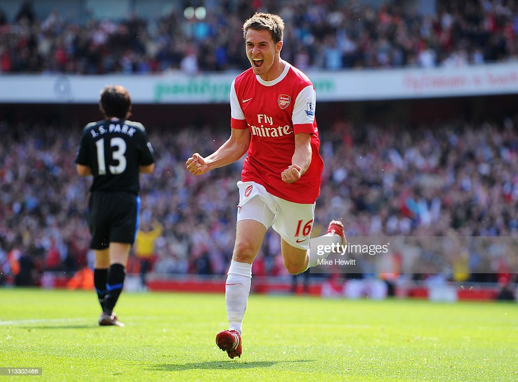 <a gi-track='captionPersonalityLinkClicked' href=/galleries/search?phrase=Aaron+Ramsey+-+Soccer+Player&family=editorial&specificpeople=4784114 ng-click='$event.stopPropagation()'>Aaron Ramsey</a> of Arsenal celebrates as he scores their first goal during the Barclays Premier League match between Arsenal and Manchester United at the Emirates Stadium on May 1, 2011 in London, England.