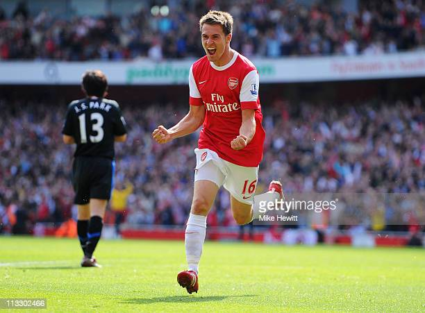 Aaron Ramsey of Arsenal celebrates as he scores their first goal during the Barclays Premier League match between Arsenal and Manchester United at...