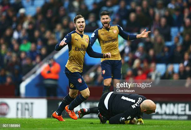 Aaron Ramsey of Arsenal celebrates as he scores their second goal past Brad Guzan of Aston Villa during the Barclays Premier League match between...