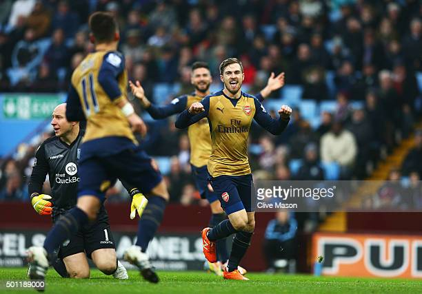 Aaron Ramsey of Arsenal celebrates as he scores their second goal with team mates during the Barclays Premier League match between Aston Villa and...