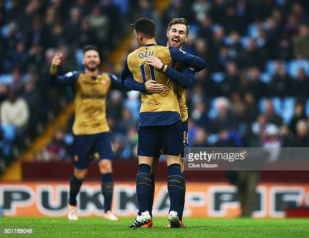 Aaron Ramsey of Arsenal celebrates as he scores their second goal with team mate Mesut Ozil during the Barclays Premier League match between Aston...