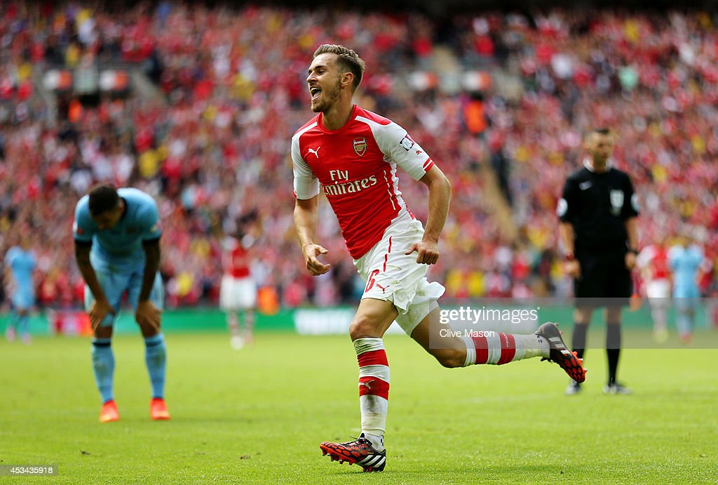 <a gi-track='captionPersonalityLinkClicked' href=/galleries/search?phrase=Aaron+Ramsey&family=editorial&specificpeople=4784114 ng-click='$event.stopPropagation()'>Aaron Ramsey</a> of Arsenal celebrates his goal during the FA Community Shield match between Manchester City and Arsenal at Wembley Stadium on August 10, 2014 in London, England.