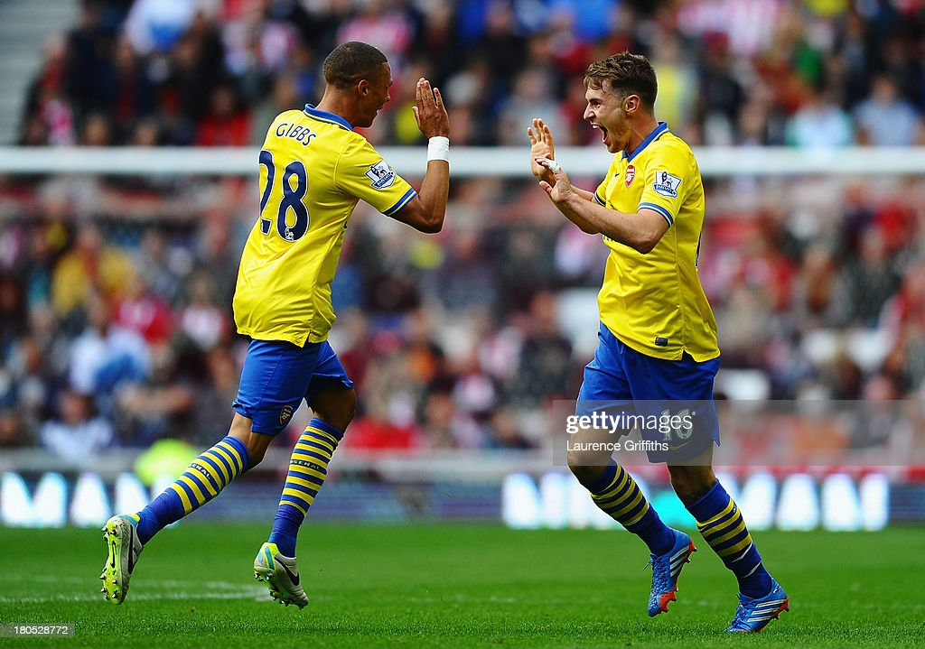 <a gi-track='captionPersonalityLinkClicked' href=/galleries/search?phrase=Aaron+Ramsey&family=editorial&specificpeople=4784114 ng-click='$event.stopPropagation()'>Aaron Ramsey</a> (R) of Arsenal celebrates his goal with team mate <a gi-track='captionPersonalityLinkClicked' href=/galleries/search?phrase=Kieran+Gibbs&family=editorial&specificpeople=4192585 ng-click='$event.stopPropagation()'>Kieran Gibbs</a> during the Barclays Premier League match between Sunderland and Arsenal at the Stadium of Light on September 14, 2013 in Sunderland, England.