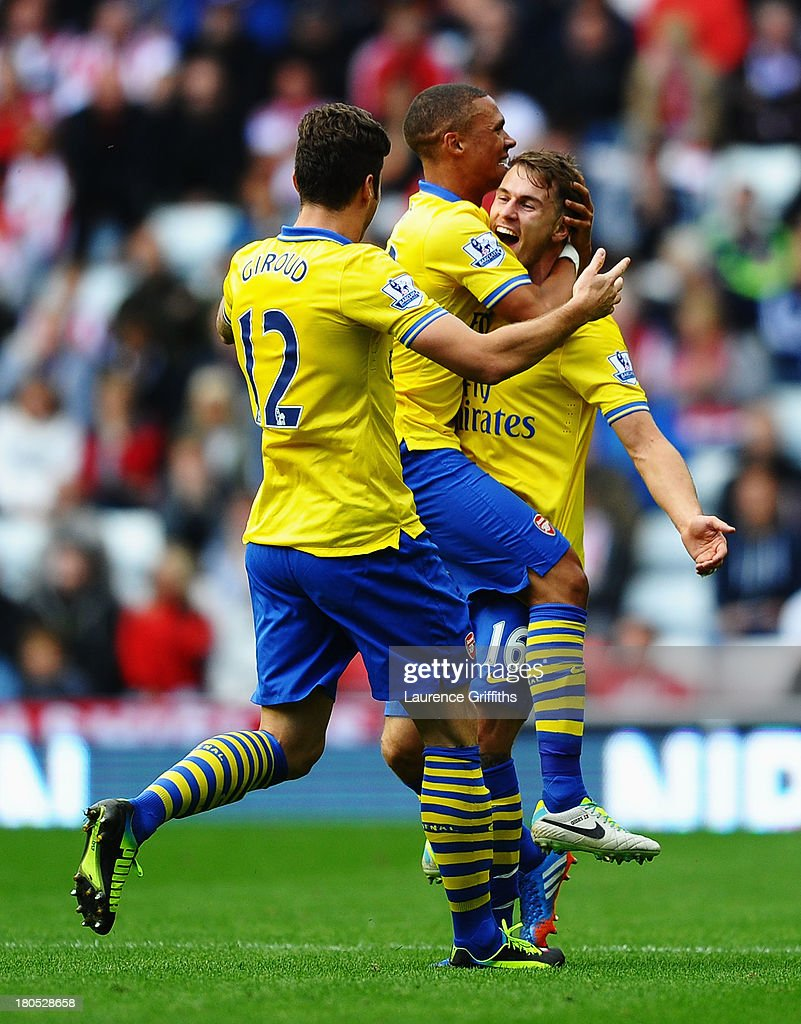 <a gi-track='captionPersonalityLinkClicked' href=/galleries/search?phrase=Aaron+Ramsey&family=editorial&specificpeople=4784114 ng-click='$event.stopPropagation()'>Aaron Ramsey</a> (R) of Arsenal celebrates his goal with team mates <a gi-track='captionPersonalityLinkClicked' href=/galleries/search?phrase=Kieran+Gibbs&family=editorial&specificpeople=4192585 ng-click='$event.stopPropagation()'>Kieran Gibbs</a> and <a gi-track='captionPersonalityLinkClicked' href=/galleries/search?phrase=Olivier+Giroud&family=editorial&specificpeople=5678034 ng-click='$event.stopPropagation()'>Olivier Giroud</a> during the Barclays Premier League match between Sunderland and Arsenal at the Stadium of Light on September 14, 2013 in Sunderland, England.