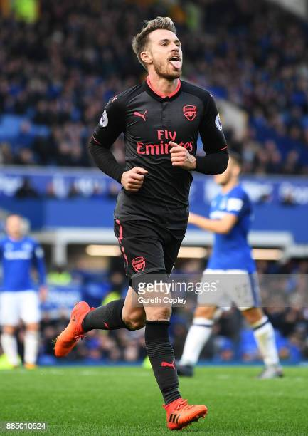 Aaron Ramsey of Arsenal celebrates scoring his sides fourth goal during the Premier League match between Everton and Arsenal at Goodison Park on...