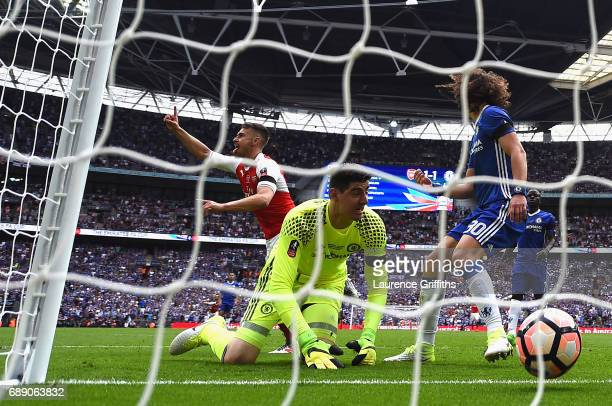 Aaron Ramsey of Arsenal celebrates scoring his sides second goal past Thibaut Courtois of Chelsea during The Emirates FA Cup Final between Arsenal...