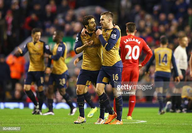 Aaron Ramsey of Arsenal celebrates scoring his team's first goal with his team mate Mathieu Flamini during the Barclays Premier League match between...