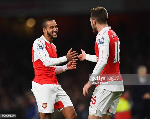Aaron Ramsey of Arsenal celebrates scoring his team's third goal with his team mate Theo Walcott during the Barclays Premier League match between...