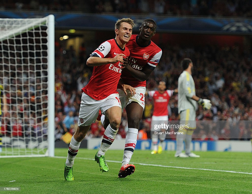 <a gi-track='captionPersonalityLinkClicked' href=/galleries/search?phrase=Aaron+Ramsey+-+Soccer+Player&family=editorial&specificpeople=4784114 ng-click='$event.stopPropagation()'>Aaron Ramsey</a> (L) of Arsenal celebrates scoring their second goal with team-mate <a gi-track='captionPersonalityLinkClicked' href=/galleries/search?phrase=Yaya+Sanogo&family=editorial&specificpeople=5862550 ng-click='$event.stopPropagation()'>Yaya Sanogo</a> during the UEFA Champions League Play Off Second leg match between Arsenal FC and Fenerbahce SK at Emirates Stadium on August 27, 2013 in London, England.