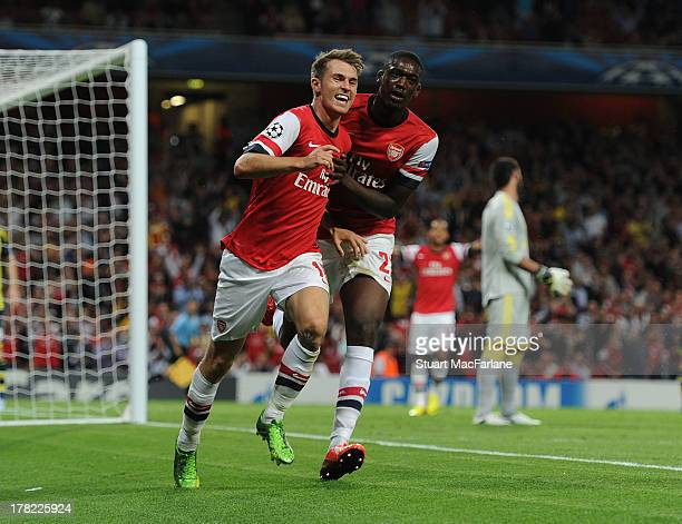 Aaron Ramsey of Arsenal celebrates scoring their second goal with teammate Yaya Sanogo during the UEFA Champions League Play Off Second leg match...