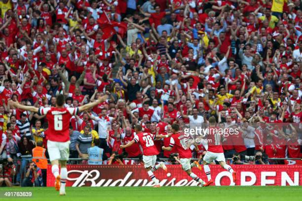 Aaron Ramsey of Arsenal celebrates with fans and team mates as he scores their third goal during the FA Cup with Budweiser Final match between...