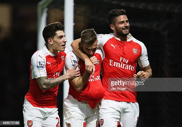 Aaron Ramsey of Arsenal celebrates with Hector Bellerin and Olivier Giroud as he scores their third goal during the Barclays Premier League match...