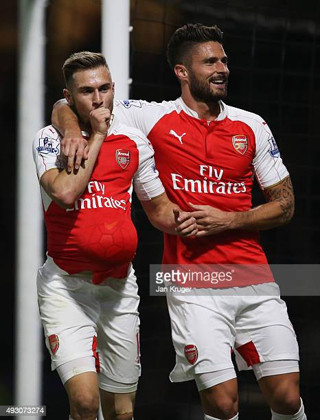 Aaron Ramsey of Arsenal celebrates with Olivier Giroud as he scores their third goal during the Barclays Premier League match between Watford and...