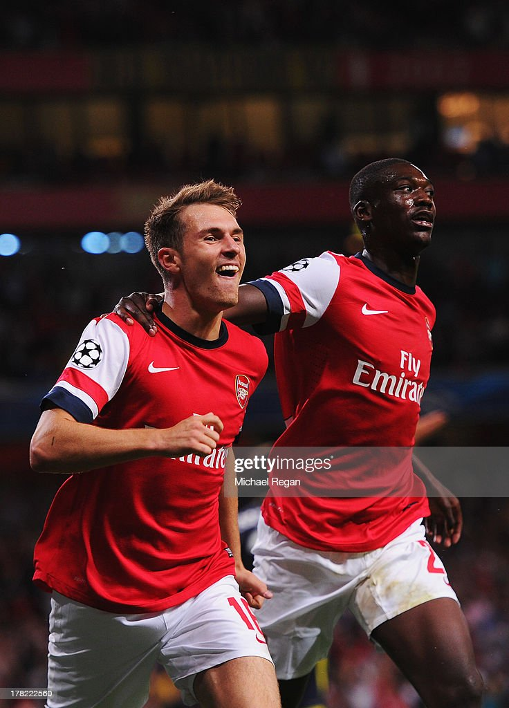 <a gi-track='captionPersonalityLinkClicked' href=/galleries/search?phrase=Aaron+Ramsey+-+Soccer+Player&family=editorial&specificpeople=4784114 ng-click='$event.stopPropagation()'>Aaron Ramsey</a> (L) of Arsenal celebrates with team mate <a gi-track='captionPersonalityLinkClicked' href=/galleries/search?phrase=Yaya+Sanogo&family=editorial&specificpeople=5862550 ng-click='$event.stopPropagation()'>Yaya Sanogo</a> after scoring his sides second goal during the UEFA Champions League Play Off Second leg match between Arsenal FC and Fenerbahce SK at Emirates Stadium on August 27, 2013 in London, England.