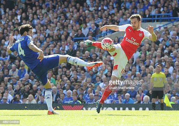 Aaron Ramsey of Arsenal challenged by Cesc Fabregas of Chelsea during the Barclays Premier League match between Chelsea and Arsenal on September 19...