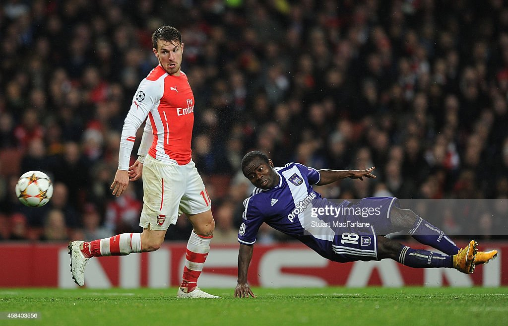 Aaron Ramsey of Arsenal challenged by Frank Acheampong during the UEFA Champions League Group D match between Arsenal and Anderlecht at Emirates...