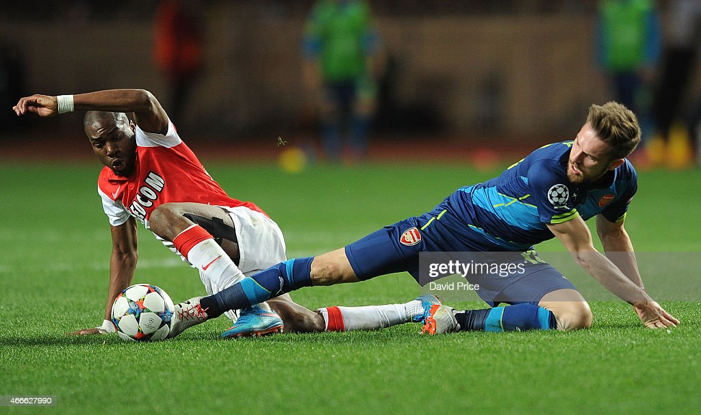 Aaron Ramsey of Arsenal challenges Geoffrey Kondogbia of Monaco during the match between AS Monaco and Arsenal at Stade Louis II on March 17, 2015 in Monaco, Monaco.