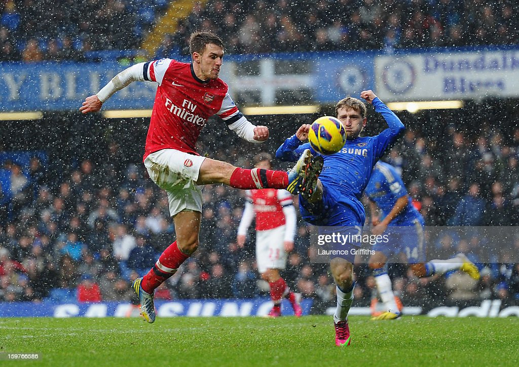 Aaron Ramsey of Arsenal challenges Marko Marin of Chelsea during the Barclays Premier League match between Chelsea and Arsenal at Stamford Bridge on January 20, 2013 in London, England.